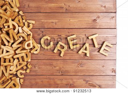Word create made with wooden letters