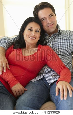 Hispanic Couple Relaxing At Home