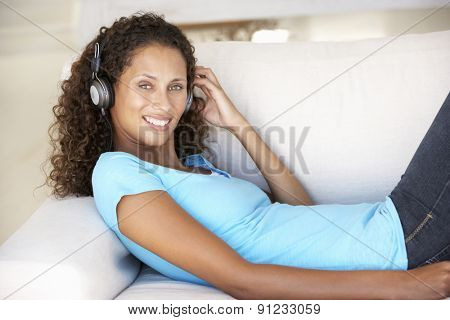 Young Woman Relaxing Listening To Music At Home