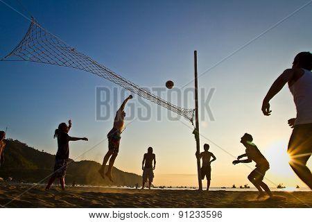Beach volleyball silhouettes in Puerto Lopez, Manabi, Ecuador