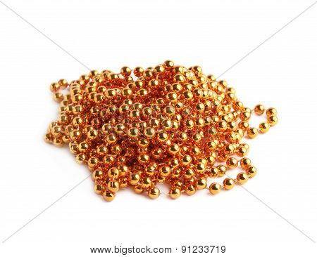 Pile of golden beads on a string