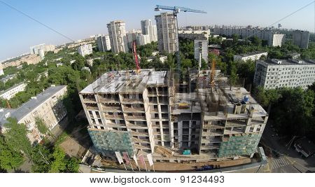 Building material lay on construction site of residential complex at spring sunny day. Aerial view
