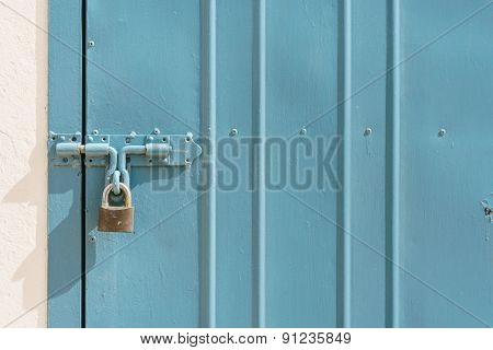 Blue Metal Door With Padlock