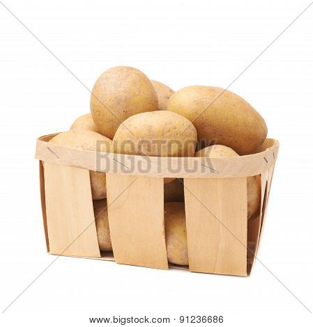 Pile of washed potatoes in a wooden basket