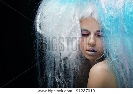 close up portrait young woman with bright make up and creative hair