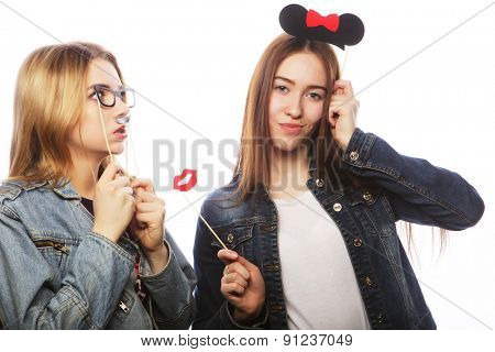 Party image. Two best girls friends. Isolated on white.
