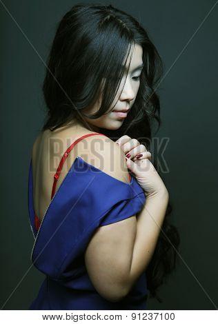 Beautiful young asian model. Studio shot.
