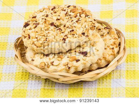 Shortbreads Rings With Peanuts In Wicker Basket On Tablecloth