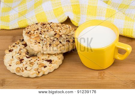 Shortbreads Rings With Peanuts And Cup Of Milk On Table