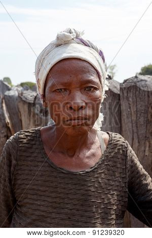Portrait Of Old Wrinkled Woman Behind Gate Of His Village