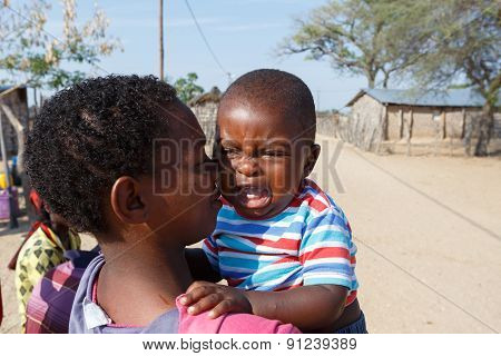 Crying Namibian Child With Mother