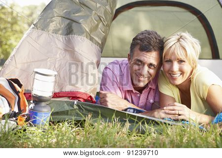 Middle Aged Couple On Camping Holiday In Countryside