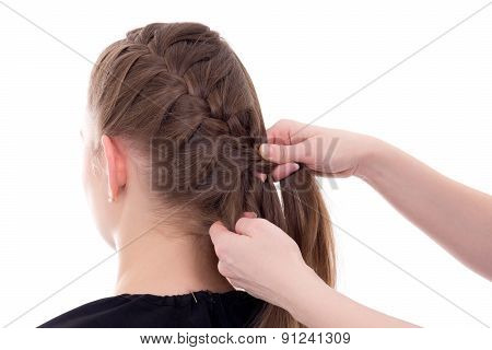 Hair Stylist Doing Plait To Young Woman Isolated On White