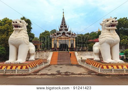 Buddhist lion statues guarding the entrance of the Mandalay hill in Myanmar (Burma)