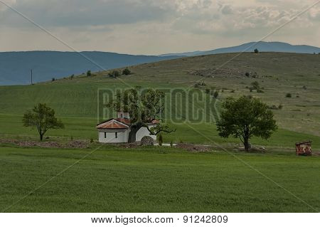 Church and chapel in green field