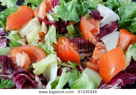 Delicious salad dressed with tomato and lettuce
