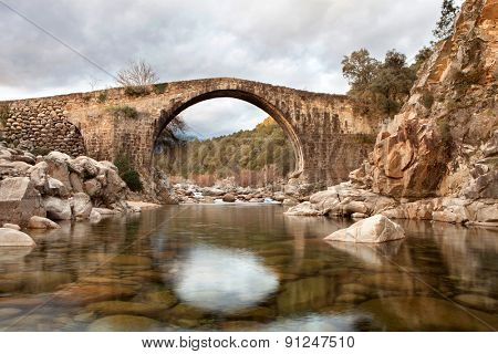 Beautiful bridge with a clear river in mountain of Spain