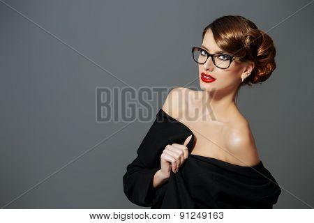 Beautiful woman wearing glasses. Beauty, fashion. Make-up. Optics, eyewear.