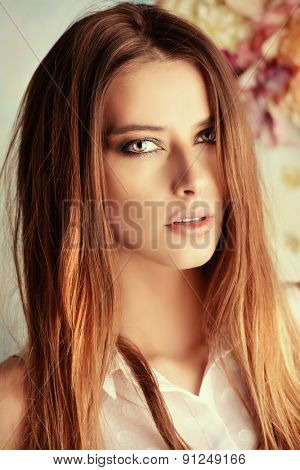 Portrait of beautiful young woman over floral background. Beauty, fashion. Cosmetics, skincare.