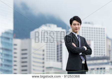 Asian businessman arm cross with business background