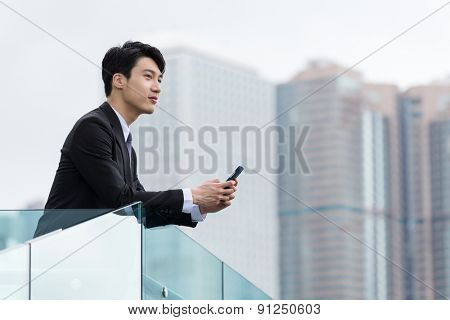 Asian businessman holding with cellphone
