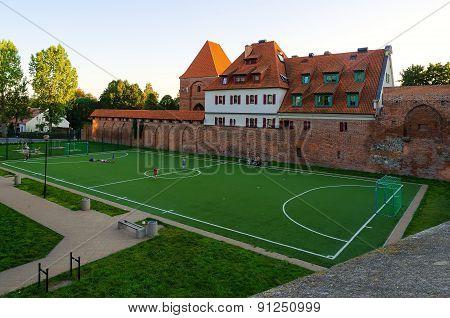 Soccer field in old town in Torun, Poland.