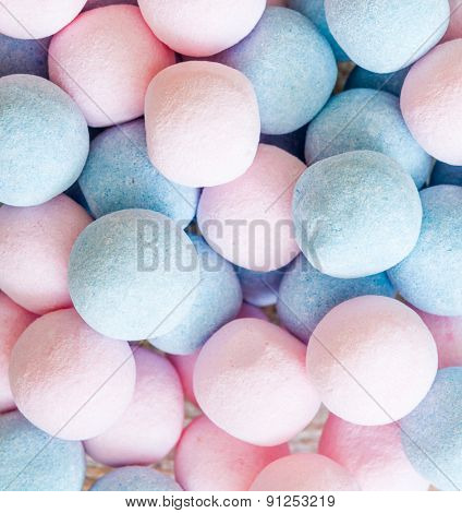 pink and blue candies and jellies as background
