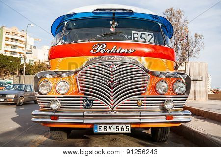Colorful old British buses from the 60's were used as public transport in Malta.