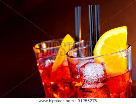 Close-up Of Two Glasses Of Spritz Aperitif Aperol Cocktail With Orange Slices And Ice Cubes