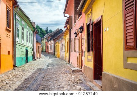 Stone Paved Old Streets With Colored Houses From Sighisoara Fortresss, Transylvania