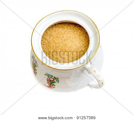 brown sugar in the sugar bowl isolated on a white background