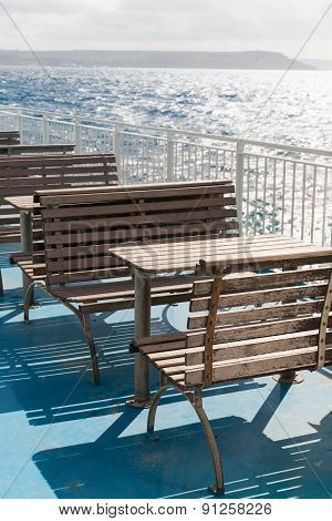 Wooden Tables And Benches On Top Deck Of Ferry. Malta, Gozo.