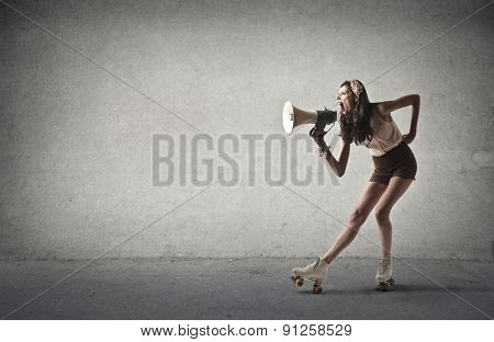 Girl yelling into a megaphone