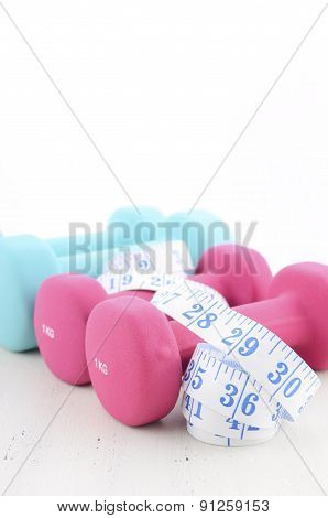 Health And Fitness Concept With Feminine Dumbbells