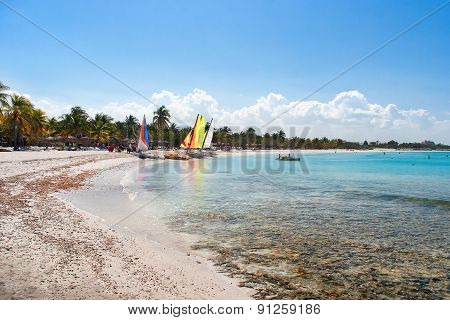 Sea Coast - White Sand, Bathing People, Sailing Vessels, Bright Palm-trees. Varadero, Cuba.