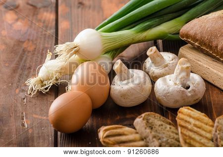 Rustic Omelette With Mushrooms On Chives