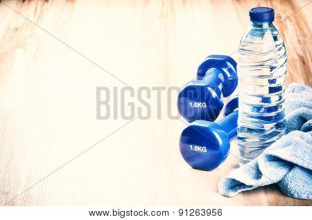 Fitness Concept With Dumbbells And Water Bottle