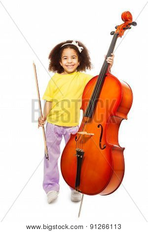 Smiling African girl holding cello and fiddlestick