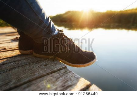 Woman relaxing on jetty