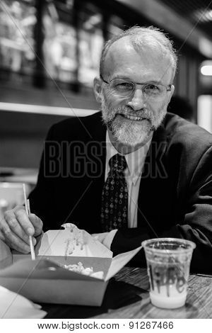 HONG KONG - MARCH 27: caucasian man eat asian food on March 27, 2013 in Hong Kong, China. Hong Kong alternatively known by its initials H.K., is situated on China's south coast.