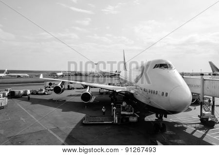 MOSCOW - MARCH 30: British Airways Boeing 747 docked in Domodedovo airport on March 30, 2014 in Moscow. British Airways (BA) is the flag carrier airline of the United Kingdom