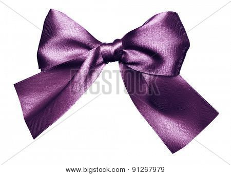 purple bow made from silk isolated