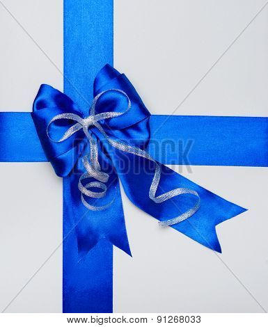 blue bow made from silk on grey