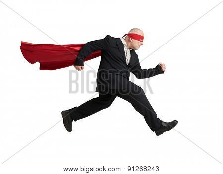 serious senior businessman wearing like superhero very fast running over light grey background