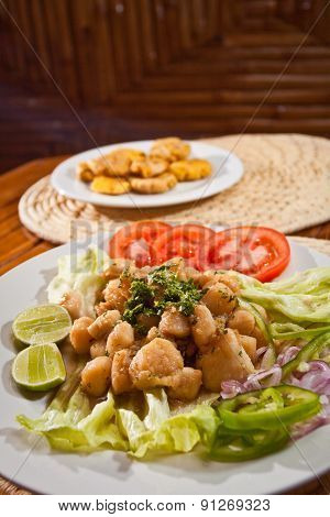 Delicious breaded calamari served with plantain chips