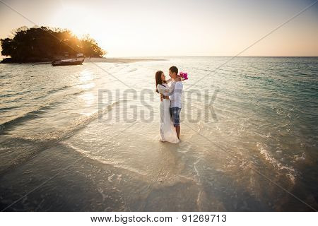 Bride And Groom Hug At Spit At Sunrise