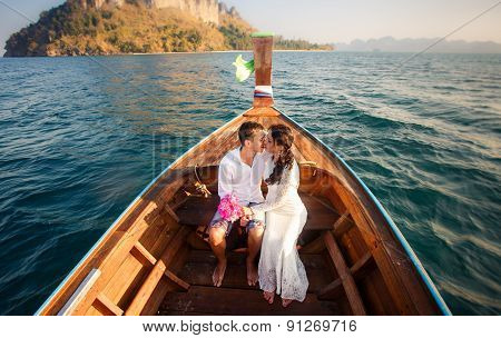 Bride And Groom Kiss In Longtail Boat