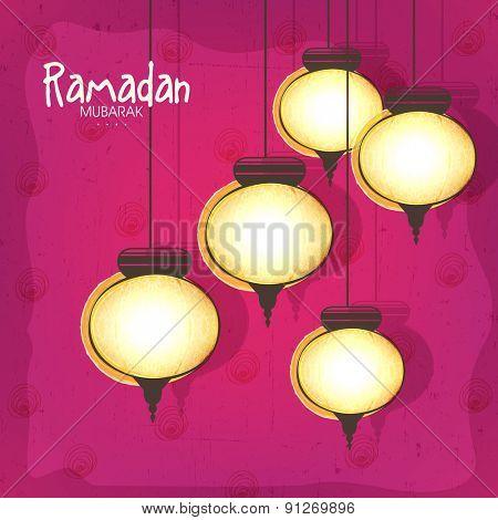 Holy month of Muslim community, Ramadan Kareem celebration with illuminated traditional lanterns hanging on pink background.