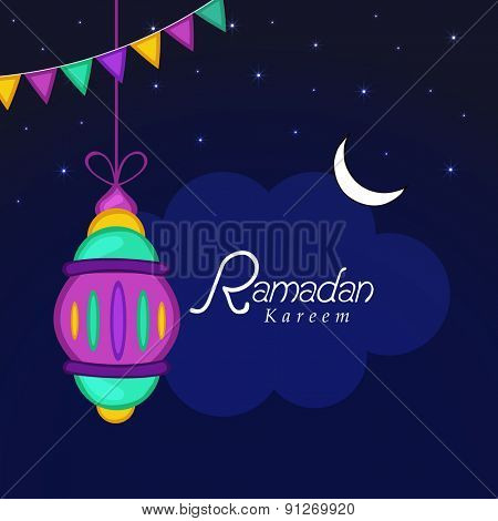 Colorful Arabic lantern on night view background for holy month of Muslim community, Ramadan Kareem celebration.