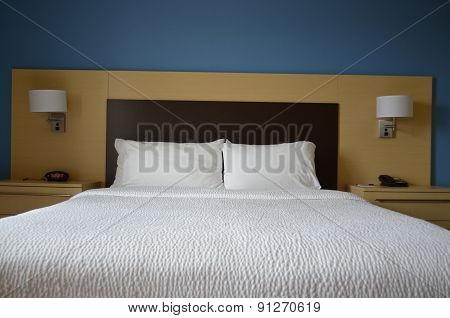 Clean white bedding on a bed